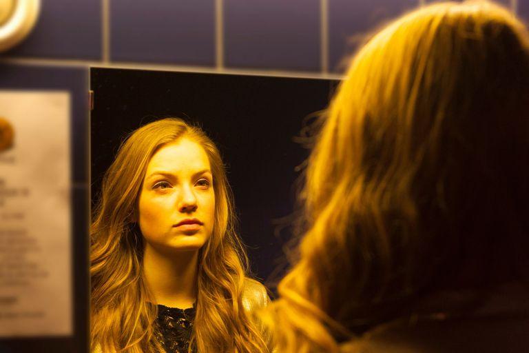 Teenager looking in mirror