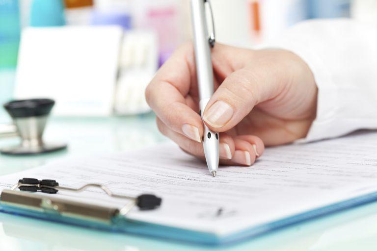 Doctor Writing on Pad