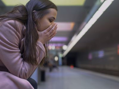 Desperate lady suffering anxiety attack at subway station, feeling helpless