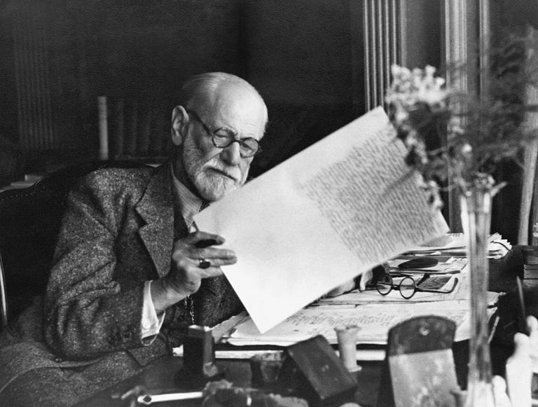 Sigmund Freud reading at his desk