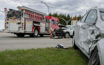 Two cars crashed in accident with firetruck behind