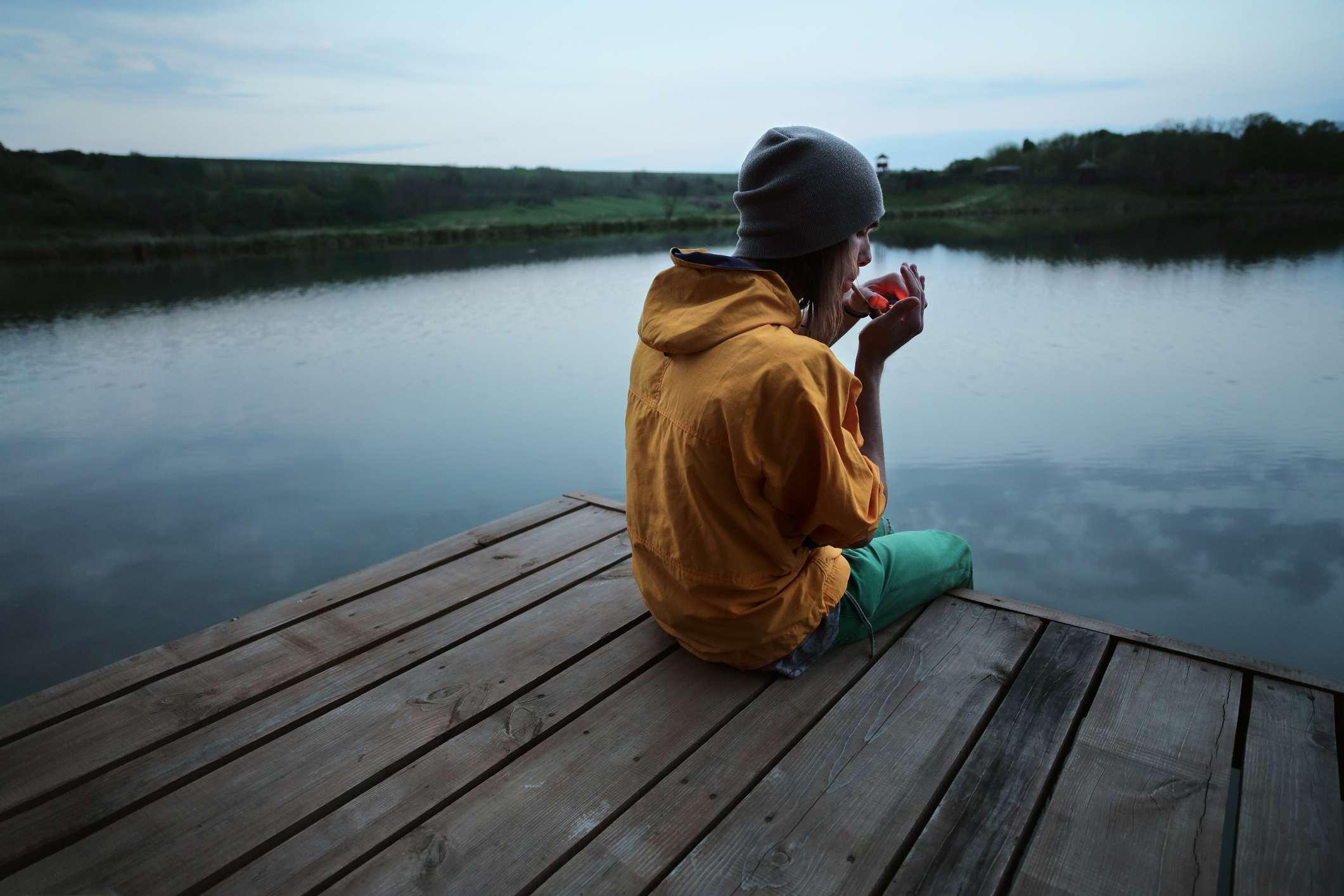 Man smoking on a dock
