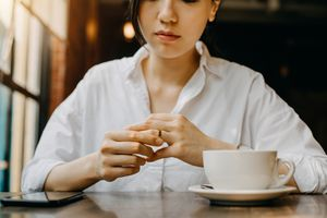 Woman touching the wedding ring on her finger nervously