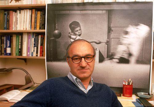 psychologist Albert Bandura sitting in offie