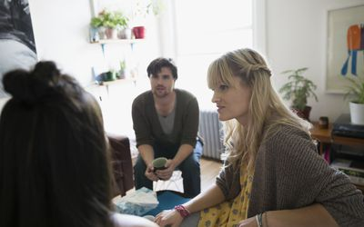 Support group talking meeting in living room