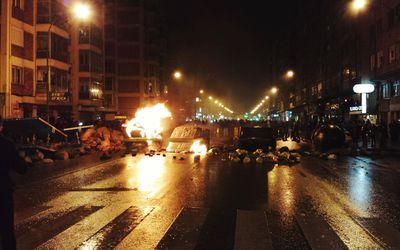 Riot On Illuminated Street At Night