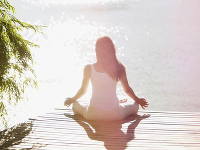 A woman practices meditation.