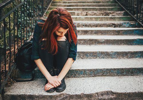 Rebellious teen on steps