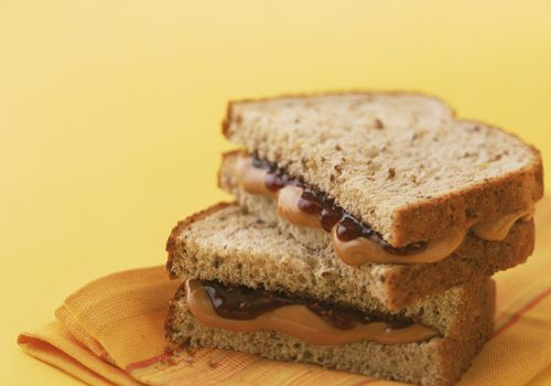 Peanut butter and jelly sandwich on whole grain bread