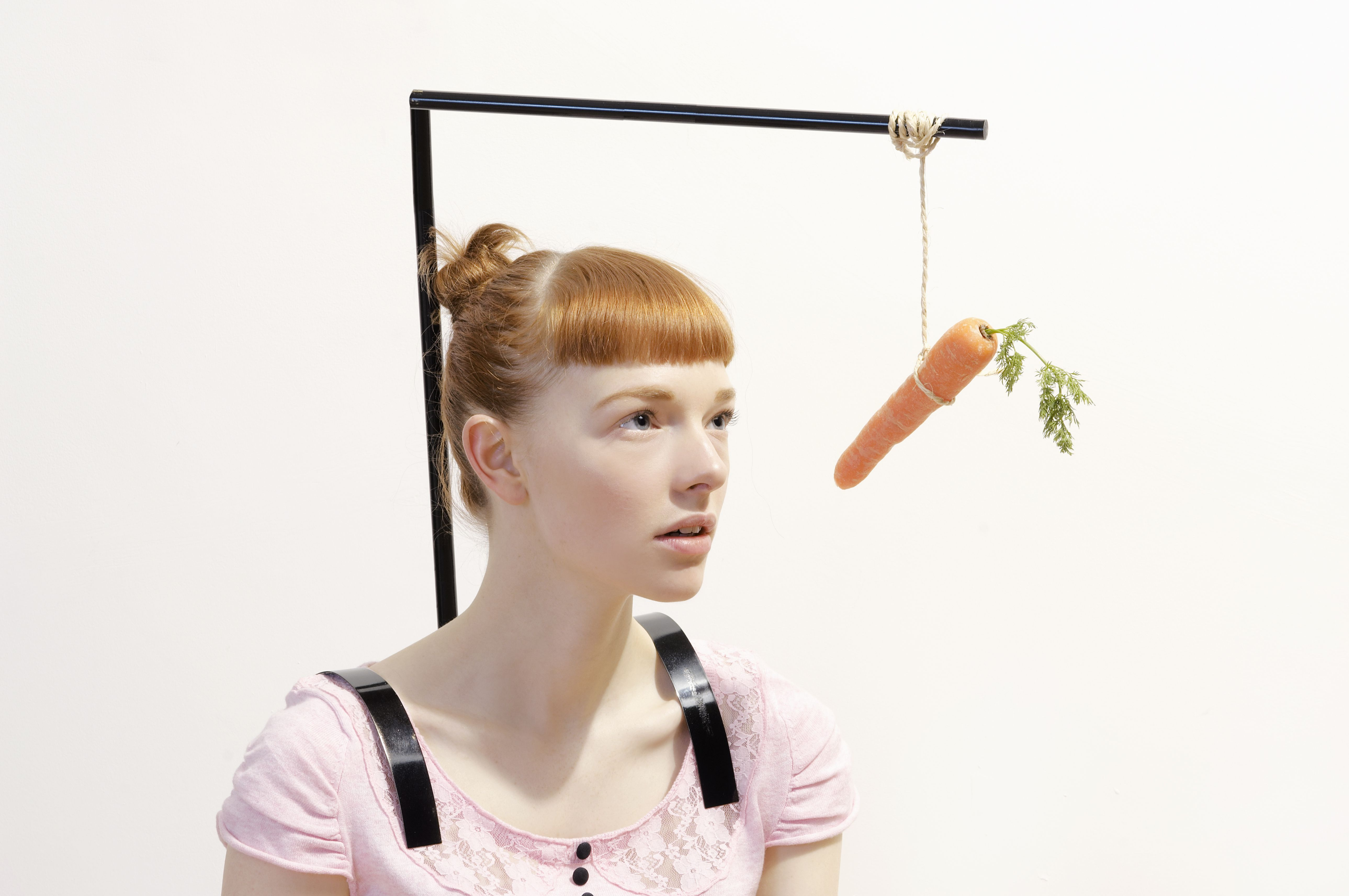 redhaired woman and carrot