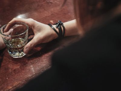 person holding a glass of whiskey