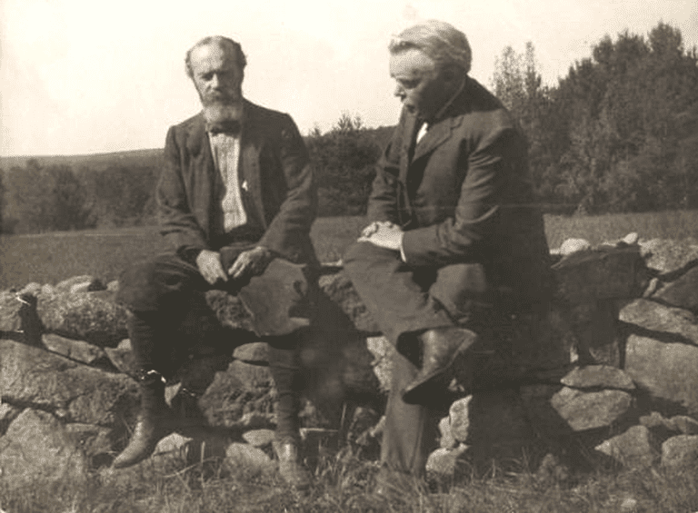 Psychologist William James sitting on a stone will with another man