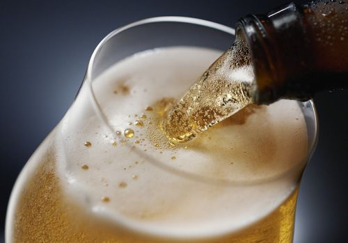 Close up of beer being poured into a glass