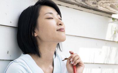 A woman having a break taking deep breaths to reduce stress