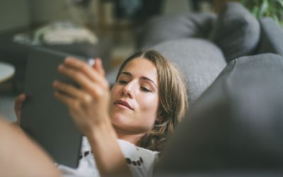 Woman reading a tablet