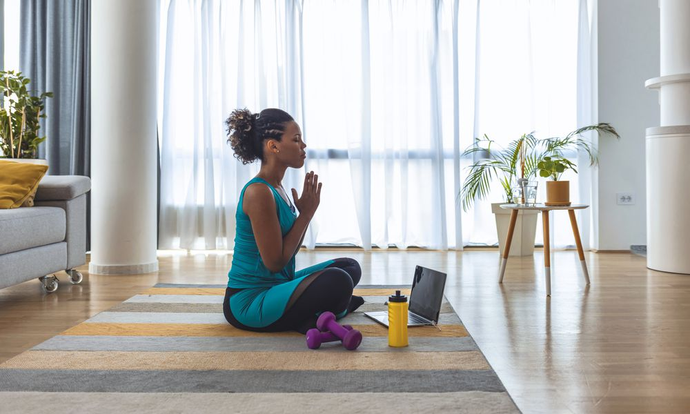 Woman meditating and finding inner peace