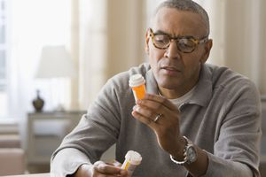Man holding prescription drugs.