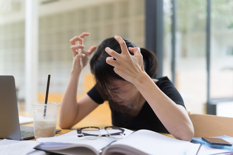 Woman frustrated while working.