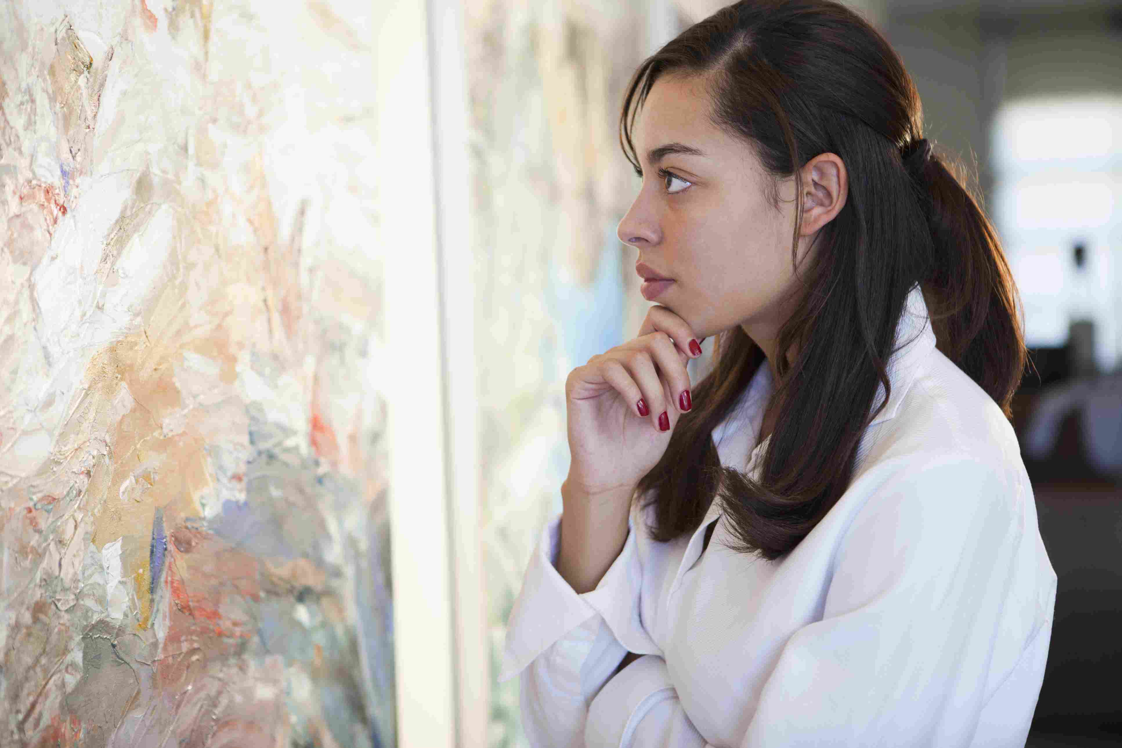 A woman looking at artwork.