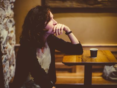 Woman deep in thought at the bar