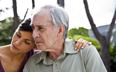 Woman sitting with senior man