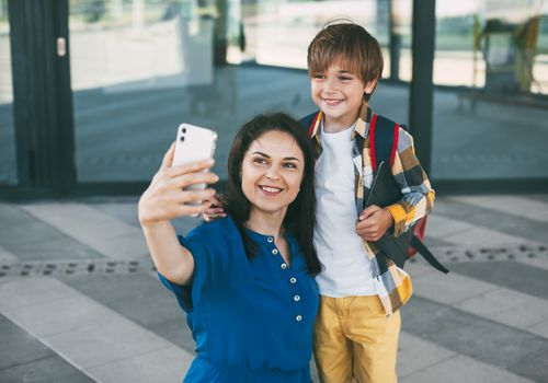 mother and son taking a selfie together