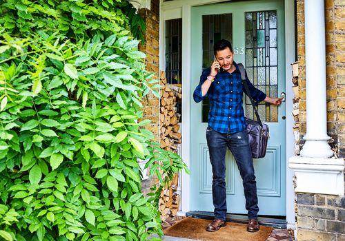 man leaving his house