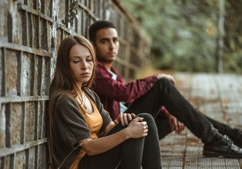 Photos showing a young couple experiencing difficulties in their relationship