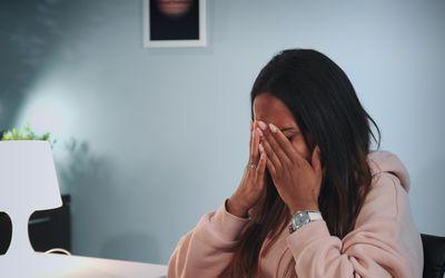 BIPOC woman crying