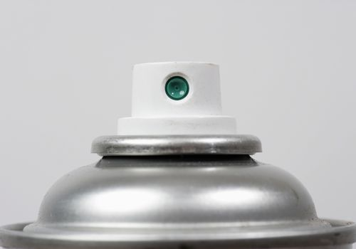 Close up of the nozzle of an aerosol can