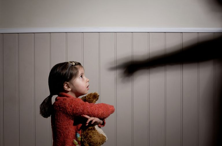 a girl being yelled at by a shadow pointing a finger