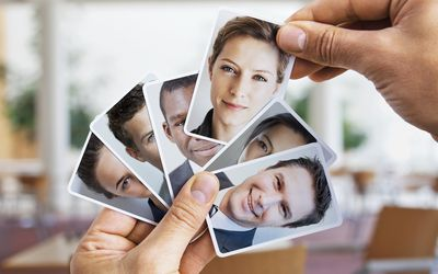 Person choosing from small portraits