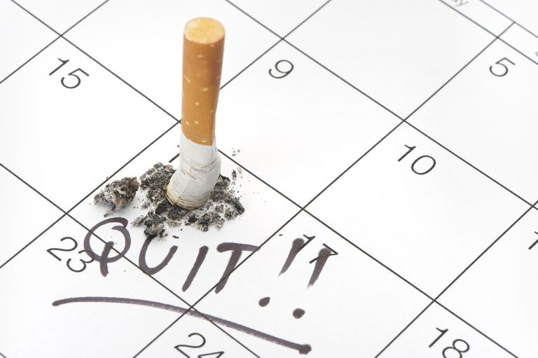 Quit date and cigarette butt on a calendar
