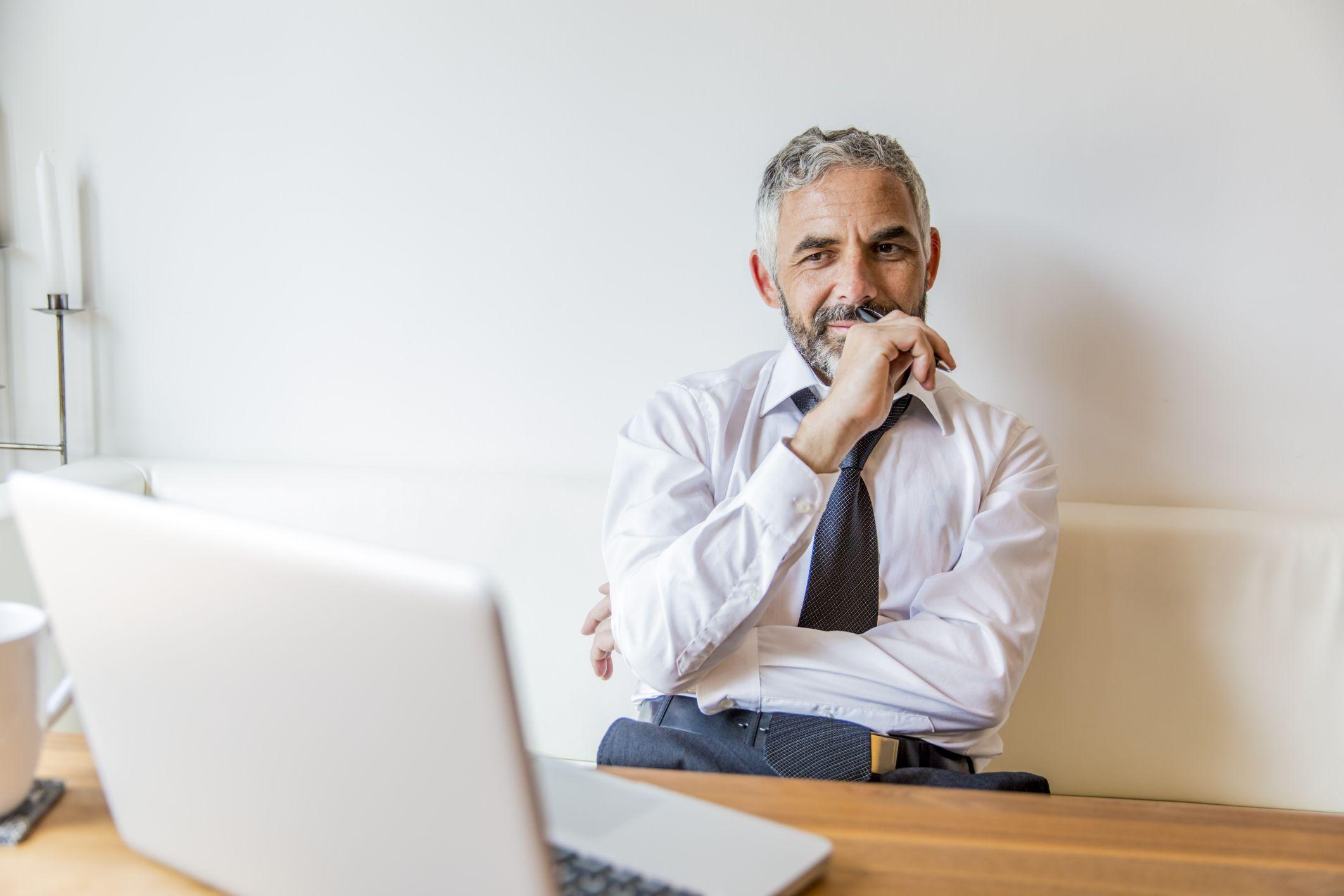 content mature man at laptop