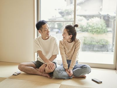 Asian couple relaxing in the Japanese-style room at home