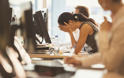 Woman stressed out in front of computer