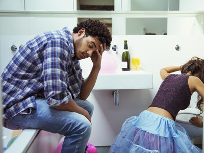 Man and woman drunk in a bathroom