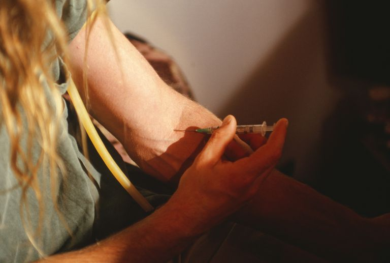 heroin user injecting into arm