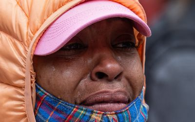 A demonstrator cries during a gathering to protest the recent death of George Floyd on May 31, 2020 in Seattle, Washington.