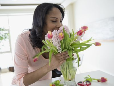 Woman smelling bouquet of flowers
