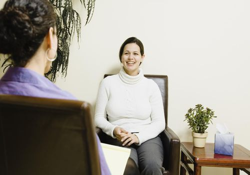 Woman smiling in therapy session