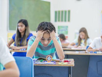 Overwhelmed boy in school