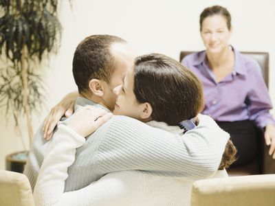 Models pose as a couple counseling triad