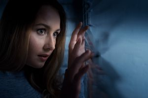 Woman looking out of the window at night