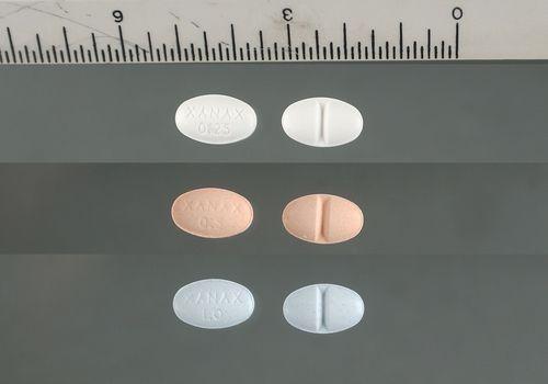 6 Xanax pills next to ruler