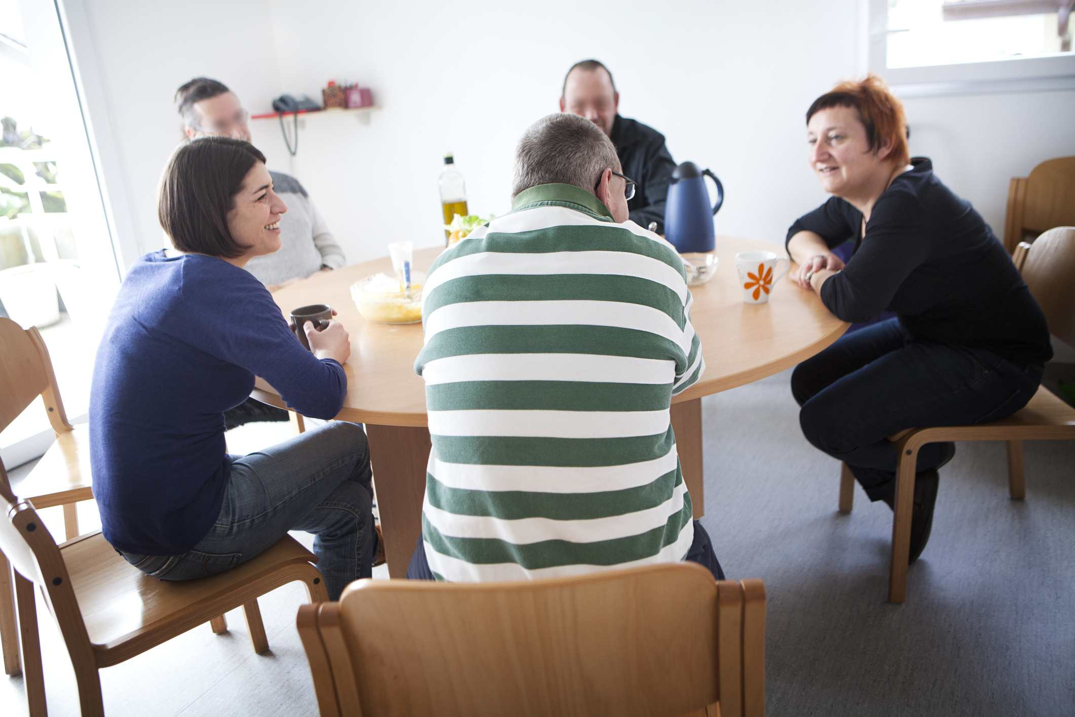 People Sitting Around Table