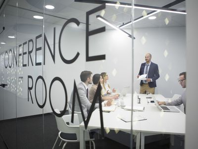 People talking in a conference room.