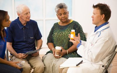 Doctor with patients discussing prescription medication abuse.