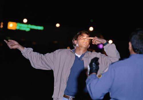 Man undergoing sobriety tests roadside