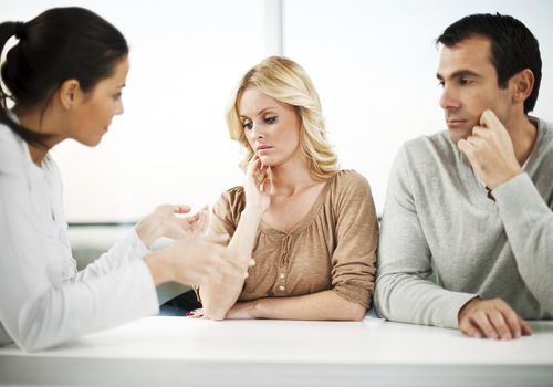 Marriage therapy. Couple with a psychiatrist.